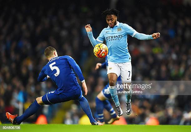 Raheem Sterling of Manchester City and John Stones of Everton compete for the ball during the Barclays Premier League match between Manchester City...