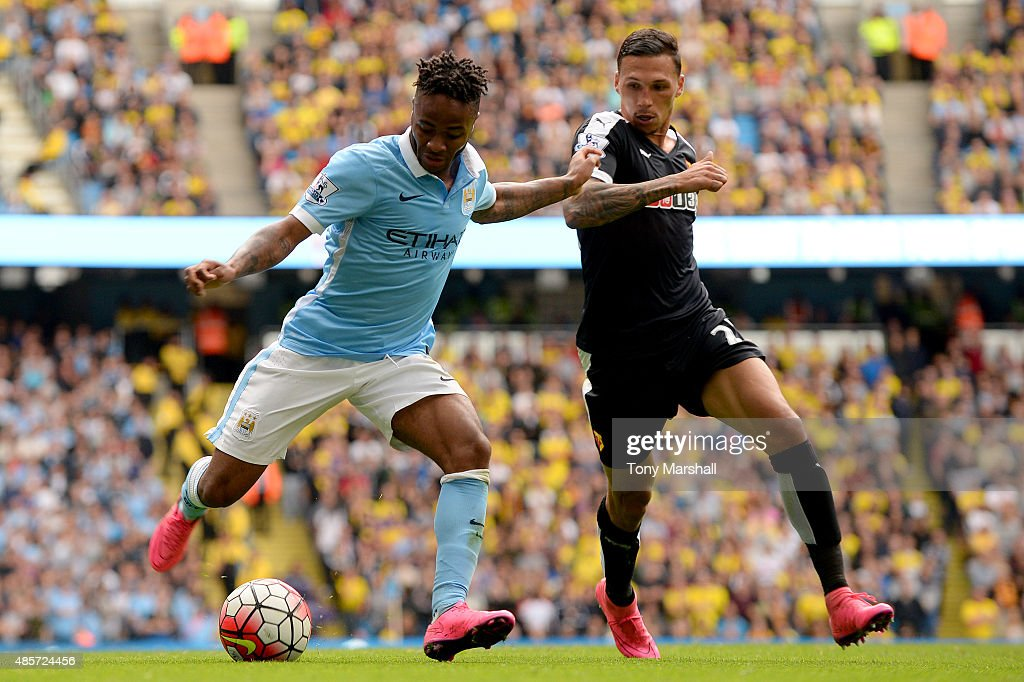 Raheem Sterling of Manchester City and Jose Holebas of Watford compete for the ball during the Barclays Premier League match between Manchester City and Watford at Etihad Stadium on August 29, 2015 in Manchester, England.