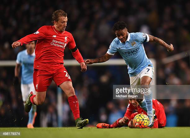 Raheem Sterling of Manchester City and Lucas Leiva of Liverpool compete for the ball during the Barclays Premier League match between Manchester City...
