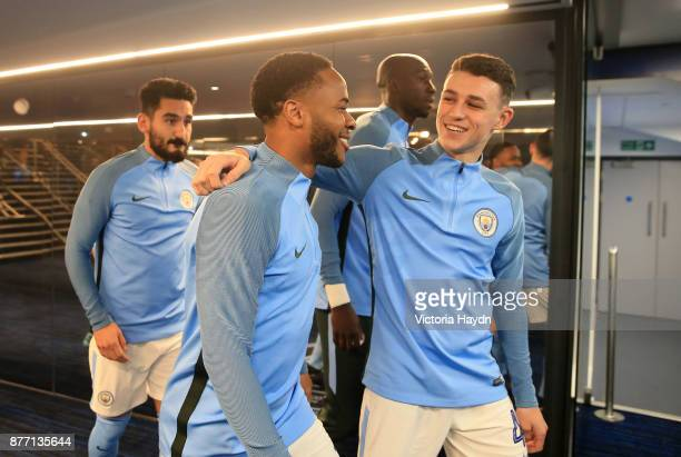 Raheem Sterling of Manchester City and Phil Foden of Manchester City share a joke prior to the UEFA Champions League group F match between Manchester...