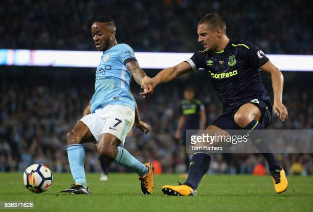 Raheem Sterling of Manchester City and Phil Jagielka of Everton in action during the Premier League match between Manchester City and Everton at...