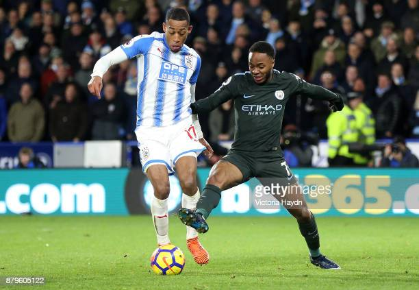 Raheem Sterling of Manchester City and Rajiv van La Parra of Huddersfield Town during the Premier League match between Huddersfield Town and...