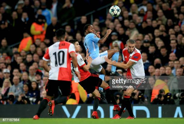 Raheem Sterling of Manchester City and Sven van Beek of Feyenoord in action during the UEFA Champions League group F match between Manchester City...