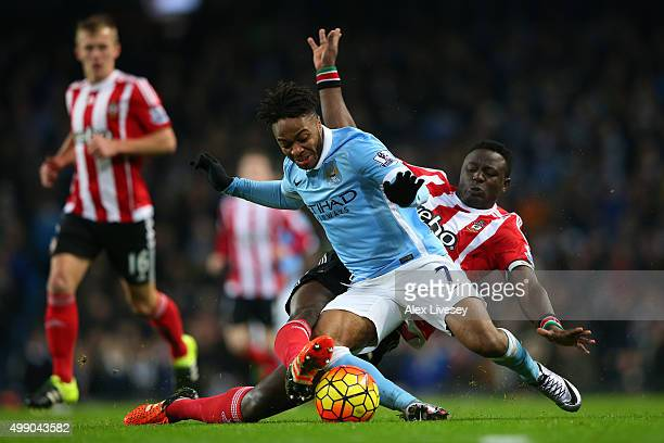 Raheem Sterling of Manchester City and Victor Wanyama of Southampton compete for the ball during the Barclays Premier League match between Manchester...
