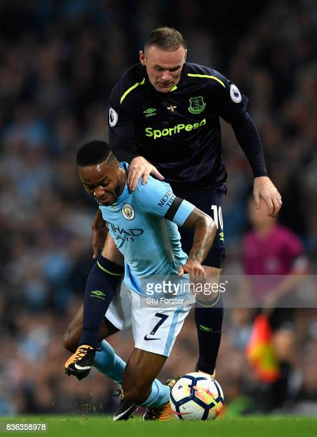 Raheem Sterling of Manchester City and Wayne Rooney of Everton battle for possession during the Premier League match between Manchester City and...