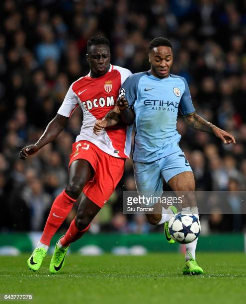 Raheem Sterling of Manchester City battles for the ball with Benjamin Mendy during the UEFA Champions League Round of 16 first leg match between...