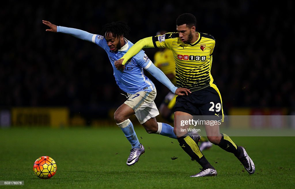 Raheem Sterling of Manchester City battles for the ball with Etienne Capoue of Watford during the Barclays Premier League match between Watford and Manchester City at Vicarage Road on January 2, 2016 in Watford, England.