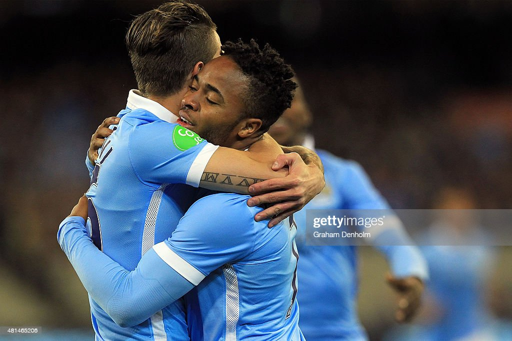 Raheem Sterling of Manchester City (R) celebrates a goal during the International Champions Cup match between Manchester City and AS Roma at Melbourne Cricket Ground on July 21, 2015 in Melbourne, Australia.