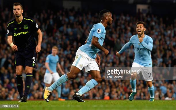 Raheem Sterling of Manchester City celebrates after scoring his sides first goal with Bernardo Silva of Manchester City during the Premier League...