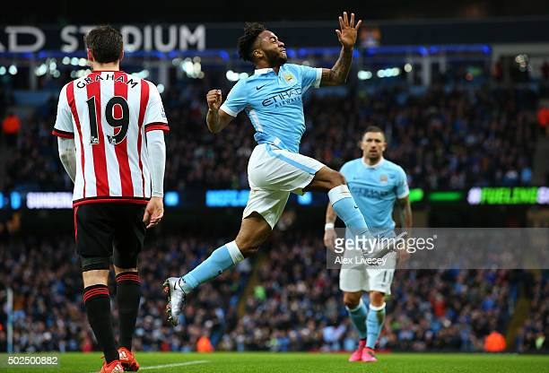 Raheem Sterling of Manchester City celebrates after scoring the opening goal with a header during the Barclays Premier League match between...