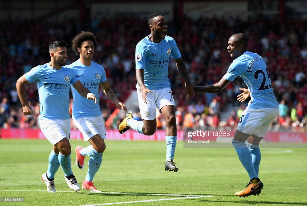 Raheem Sterling of Manchester City celebrates scoring his sides second goal with his Manchester City team mates during the Premier League match between AFC Bournemouth and Manchester City at Vitality Stadium on August 26, 2017 in Bournemouth, England.