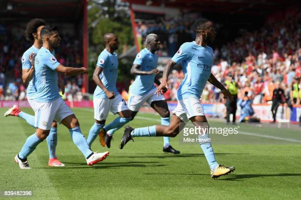 Raheem Sterling of Manchester City celebrates scoring his sides second goal with his Manchester City team mates during the Premier League match...