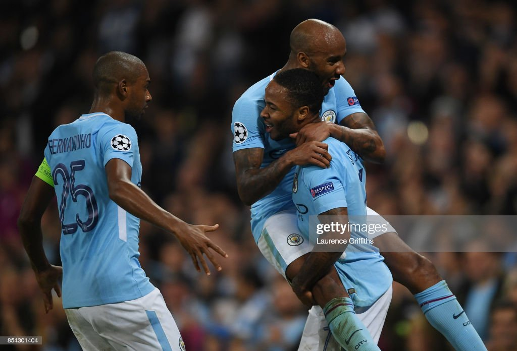 Raheem Sterling of Manchester City celebrates scoring his sides second goal with Fabian Delph of Manchester City and Fernandinho of Manchester City during the UEFA Champions League Group F match between Manchester City and Shakhtar Donetsk at Etihad Stadium on September 26, 2017 in Manchester, United Kingdom.