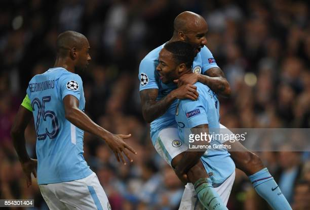 Raheem Sterling of Manchester City celebrates scoring his sides second goal with Fabian Delph of Manchester City and Fernandinho of Manchester City...