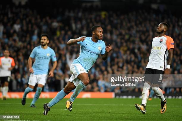 Raheem Sterling of Manchester City celebrates scoring his sides second goal during the UEFA Champions League Group F match between Manchester City...