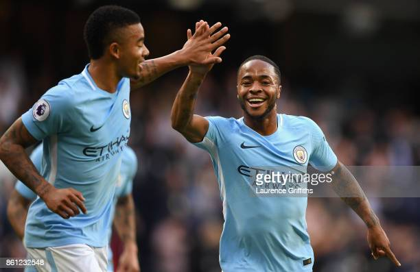 Raheem Sterling of Manchester City celebrates scoring his sides second goal with Gabriel Jesus of Manchester City during the Premier League match...