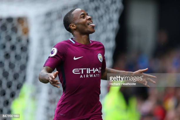 Raheem Sterling of Manchester City celebrates scoring his sides sixth goal during the Premier League match between Watford and Manchester City at...