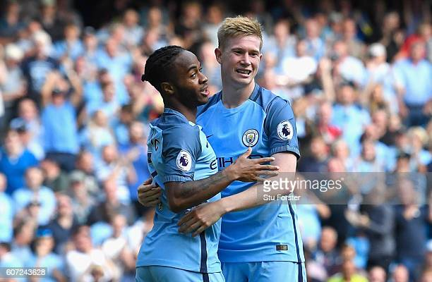 Raheem Sterling of Manchester City celebrates scoring his sides third goal with Kevin De Bruyne of Manchester City during the Premier League match...