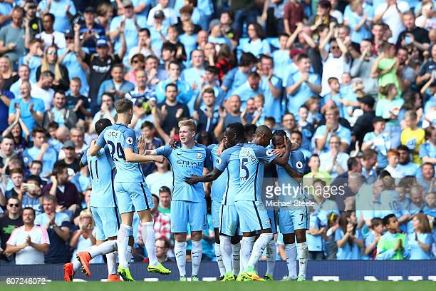 Raheem Sterling of Manchester City celebrates scoring his sides third goal with his team mates during the Premier League match between Manchester...