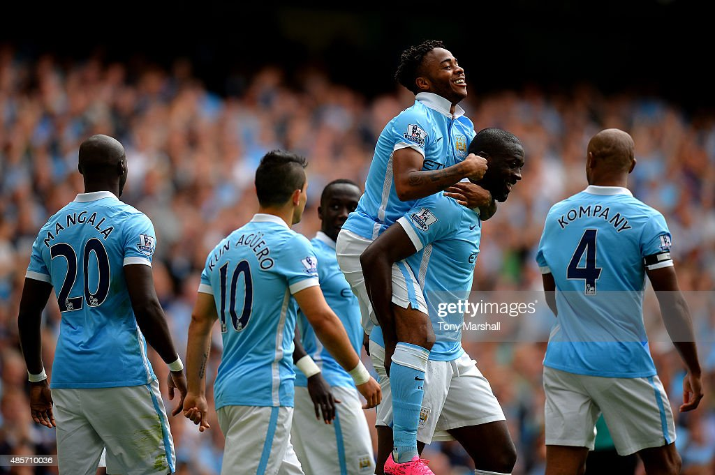 Raheem Sterling (3rd R) of Manchester City celebrates scoring his team's first goal with his team mates during the Barclays Premier League match between Manchester City and Watford at Etihad Stadium on August 29, 2015 in Manchester, England.