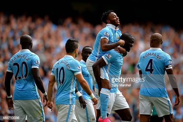 Raheem Sterling of Manchester City celebrates scoring his team's first goal with his team mates during the Barclays Premier League match between...