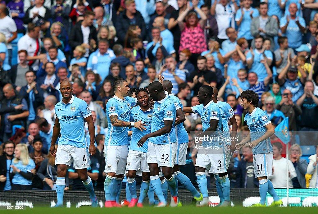 Raheem Sterling (3rd L) of Manchester City celebrates scoring his team's first goal with his team mates during the Barclays Premier League match between Manchester City and Watford at Etihad Stadium on August 29, 2015 in Manchester, England.