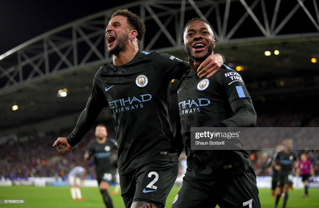 Raheem Sterling of Manchester City celebrates scoring the 2nd Manchester City goal with Kyle Walker of Manchester City during the Premier League match between Huddersfield Town and Manchester City at John Smith's Stadium on November 26, 2017 in Huddersfield, England.