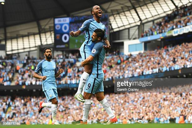 Raheem Sterling of Manchester City celebrates scoring the opening goal with Nolito during the Premier League match between Manchester City and West...