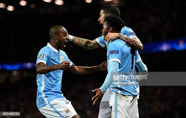 Raheem Sterling of Manchester City celebrates with Fernandinho of Manchester City and Aleksandar Kolarov of Manchester City after scoring his side's...