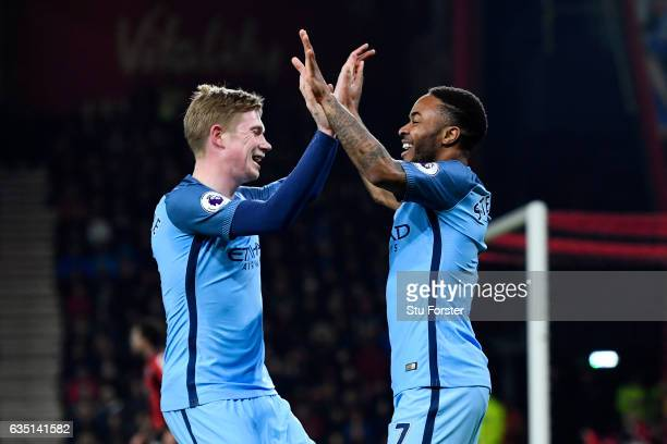 Raheem Sterling of Manchester City celebrates with Kevin De Bruyne after scoring the opening goal during the Premier League match between AFC...