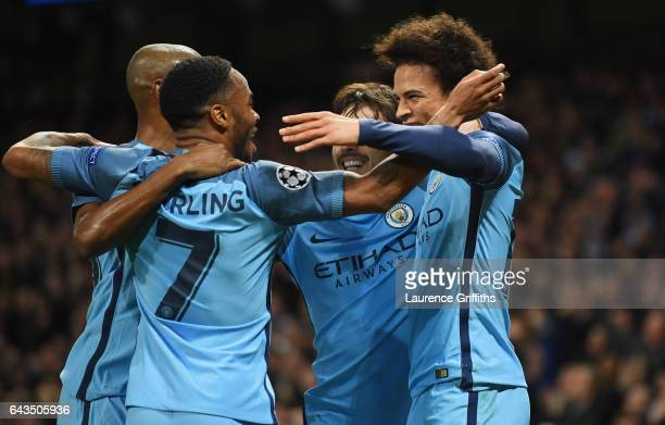 Raheem Sterling of Manchester City celebrates with team mates as he scores their first goal during the UEFA Champions League Round of 16 first leg...