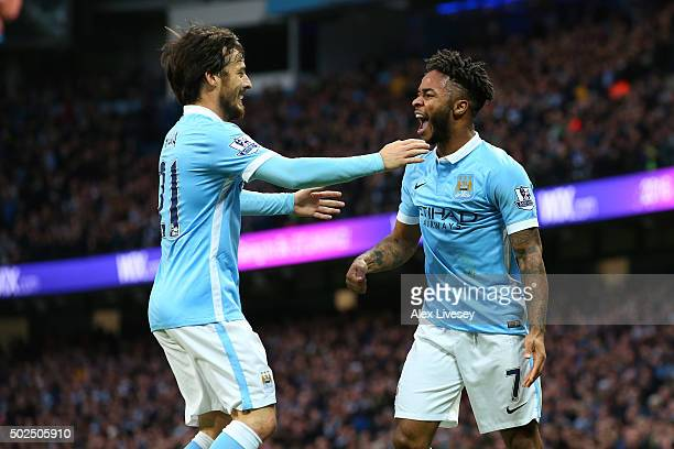 Raheem Sterling of Manchester City celebrates with teammate David Silva after scoring the opening goal with a header during the Barclays Premier...