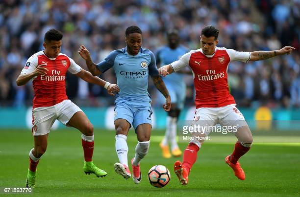 Raheem Sterling of Manchester City controls the ball under pressure of Alexis Sanchez and Granit Xhaka of Arsenal during the Emirates FA Cup...