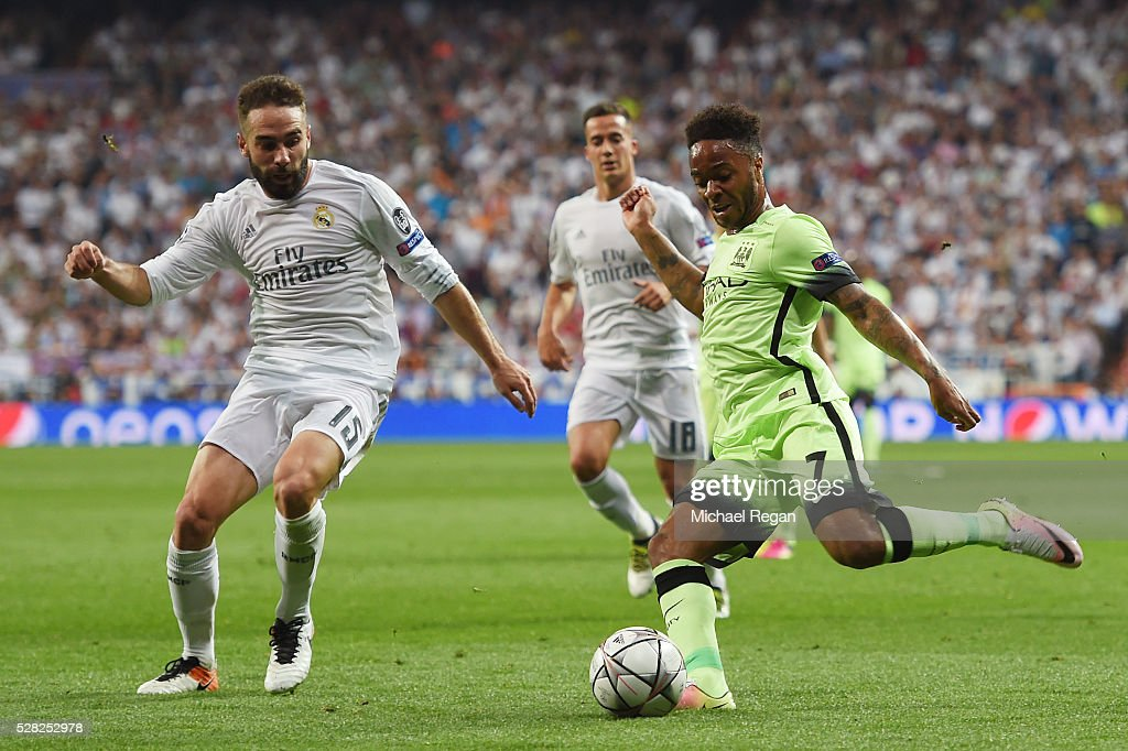 Raheem Sterling of Manchester City crosses as Daniel Carvajal of Real Madrid closes in during the UEFA Champions League semi final, second leg match between Real Madrid and Manchester City FC at Estadio Santiago Bernabeu on May 4, 2016 in Madrid, Spain.