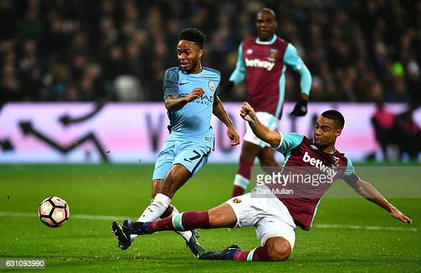 Raheem Sterling of Manchester City has his shot blocked by Winston Reid of West Ham United during The Emirates FA Cup Third Round match between West...