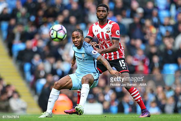 Raheem Sterling of Manchester City holds off Cuco Martina of Southampton during the Premier League match between Manchester City and Southampton at...