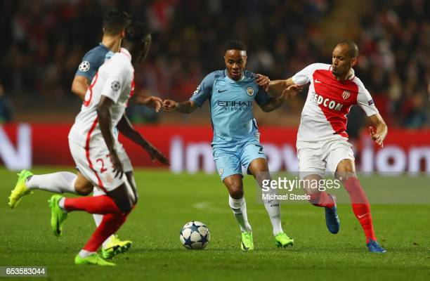 Raheem Sterling of Manchester City holds off Fabinho of AS Monaco during the UEFA Champions League Round of 16 second leg match between AS Monaco and...