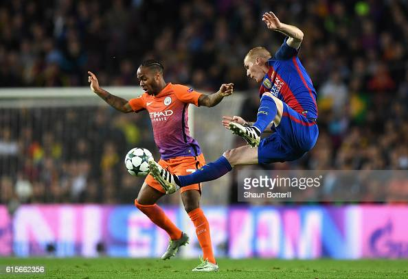 Raheem Sterling of Manchester City holds off pressure from Jeremy Mathieu of Barcelona during the UEFA Champions League group C match between FC...