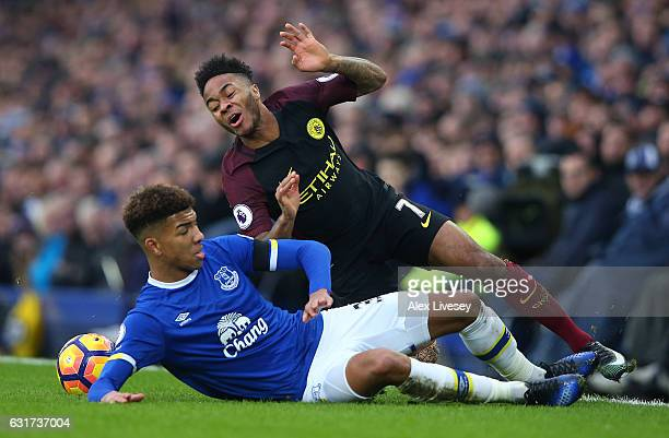 Raheem Sterling of Manchester City is brought down by Mason Holgate of Everton during the Premier League match between Everton and Manchester City at...