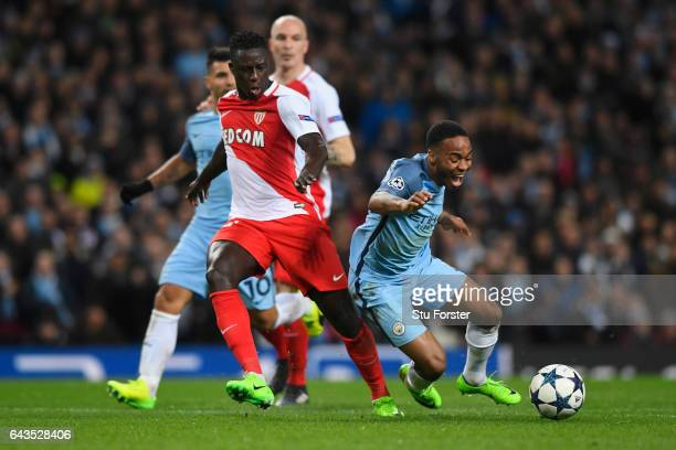 Raheem Sterling of Manchester City is challenged by Benjamin Mendy of AS Monaco during the UEFA Champions League Round of 16 first leg match between...