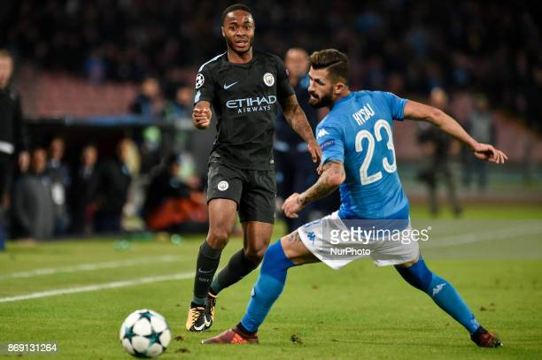 Raheem Sterling of Manchester City is challenged by Elseid Hysaj of Napoli during the UEFA Champions League match between Napoli v Manchester City at...