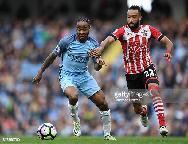 Raheem Sterling of Manchester City is challenged by Nathan Redmond of Southampton during the Premier League match between Manchester City and...