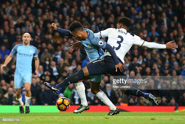 Raheem Sterling of Manchester City is challenged in the penalty area by Danny Rose of Tottenham Hotspur during the Premier League match between...