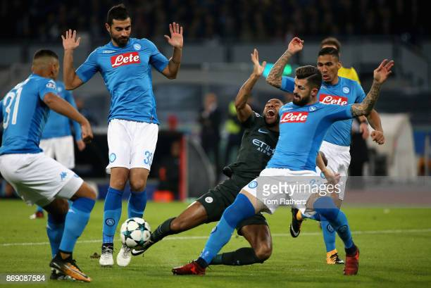 Raheem Sterling of Manchester City is fouled by Elseid Hysaj of SSC Napoli during the UEFA Champions League group F match between SSC Napoli and...