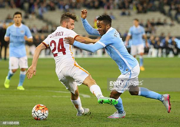 Raheem Sterling of Manchester City is tackled by Alessandro Florenzi of AS Roma during the International Champions Cup friendly match between...