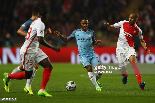 Raheem Sterling of Manchester City is tracked by Fabinho of Monaco during the UEFA Champions League Round of 16 second leg match between AS Monaco...