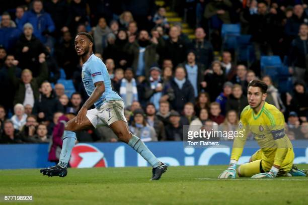 Raheem Sterling of Manchester City looks on as he scores his sides first goal past goalkeeper Brad Jones of Feyenoord during the UEFA Champions...