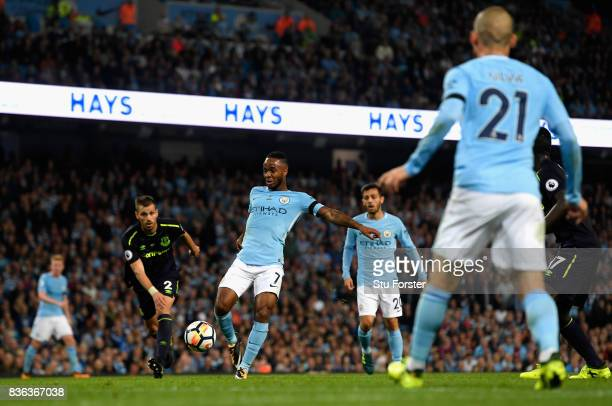 Raheem Sterling of Manchester City scores his sides first goal during the Premier League match between Manchester City and Everton at Etihad Stadium...