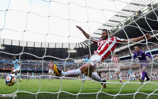 Raheem Sterling of Manchester City scores his sides second goal as Erik Pieters of Stoke City attempts to clear off the line during the Premier...