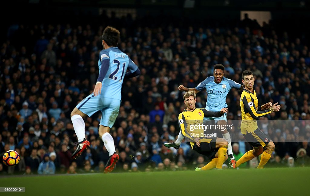 Raheem Sterling of Manchester City (R) scores his sides second goal during the Premier League match between Manchester City and Arsenal at the Etihad Stadium on December 18, 2016 in Manchester, England.